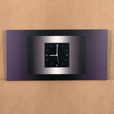 "reloj pared ""DBRI"" 70 x 35 cm."